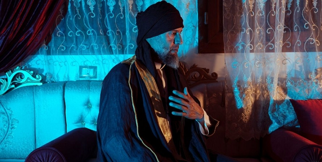 Без пальцев на руках и с седой бородой. Сын Муаммара Каддафи впервые за 10 лет дал интервью
