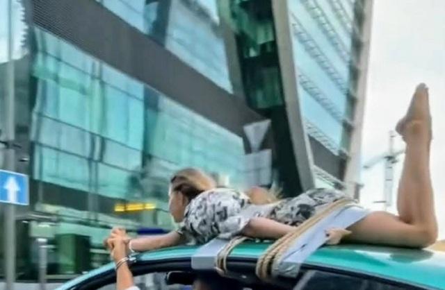 Блогер привязал девушку к крыше Bentley и прокатился на фоне «Москва-Сити»