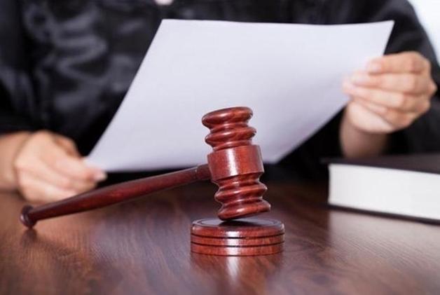 Экс-налоговик осужден на 5,5 лет за «помощь» нелегальным работникам